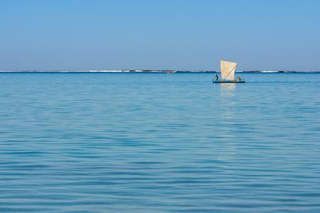 Tsifota, Madagascar, June 08, 2017:  Malagasy fishing sailboat of the Vezo ethnic group in the Ambatomilo lagoon in southwestern Madagascar