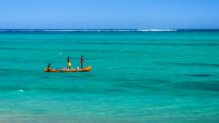 Tsifota, Madagascar, June 07, 2017: Malagasy fishermen fishing with their traditional outrigger canoe in the lagoon of southwestern Madagascar Editorial