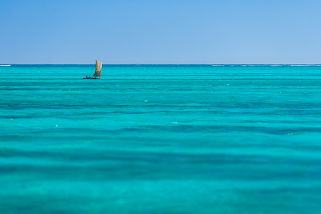 Traditional Malagasy fishing boat in the vastness of the lagoon in southwestern Madagascar