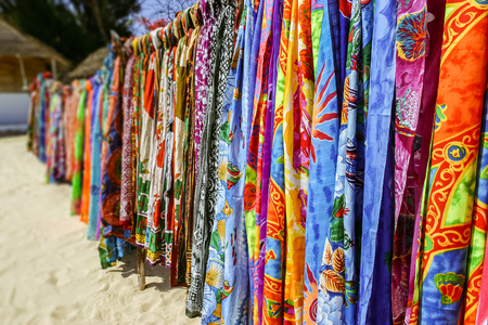Colorful pareos for sale at the beach market 스톡 콘텐츠