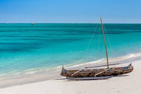 Outrigger canoe, traditional Vezo fishing boat beached in the lagoon of south-western Madagascar Stock Photo