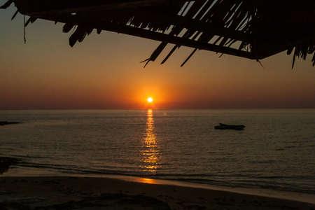 Sunset on an outrigger canoe off Ifaty beach, southwest of Madagascar Stock Photo