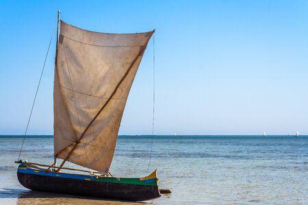 Malagasy outrigger canoe beached in Ifaty, southwest Madagascar Stock Photo