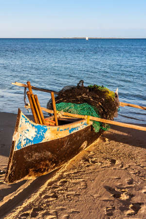Traditional fishing boat beached to Anakao, southern Madagascar Stock Photo