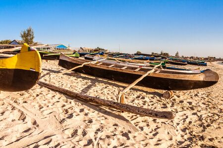 Traditional fishing dugout canoes beached to Anakao, southern Madagascar