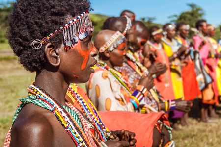 Masai Mara, Kenya, May 23, 2017: Masai women in traditional costume lined up during a ceremony Editorial