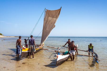 Ifaty, Madagascar, June 15, 2017: Fishing scene of Malagasy fishermen of the Vezo ethnic group beached in the lagoon of southwestern Madagascar