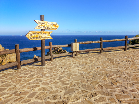 Famous tourist spot in Tangiers, Morocco, represented by a signboard indicating the junction between the Atlantic Ocean and the Mediterranean Sea by the Strait of Gibraltar