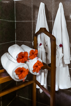 Towels and bathrobes in a tropical hotel 版權商用圖片