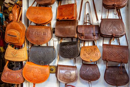 Display of handmade leather handbags in the souk of Asilah, northern morocco