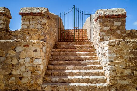Staircase leading to the metal gate of the Asilah fortification in northern Morocco Stock Photo