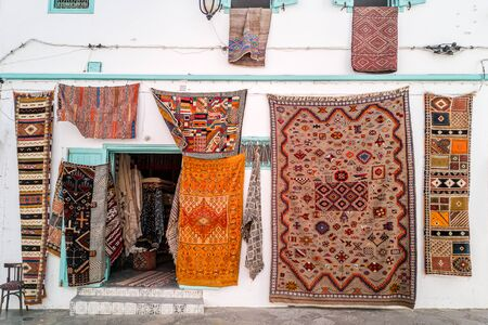Moroccan carpets in the street shop souk of Asilah, Morocco