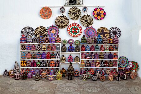 Moroccan basketry handicraft stall in Asilah, northern Morocco