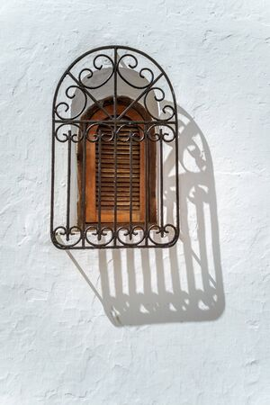 Window with styled iron grid and beautiful shadow