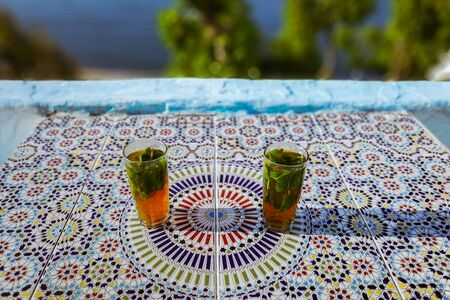 Moroccan mint tea on a terrace with sea view in Tangier, Morocco
