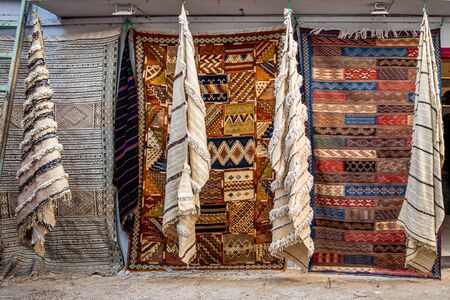 Moroccan carpets in the street shop souk of Asilah, Morocco Stock Photo