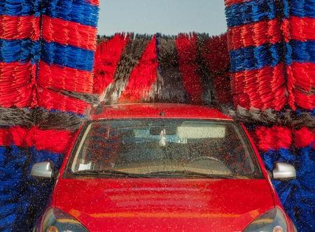 Car between washing rollers