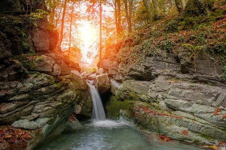 waterfall of river water in the forest in autumn Stock Photo