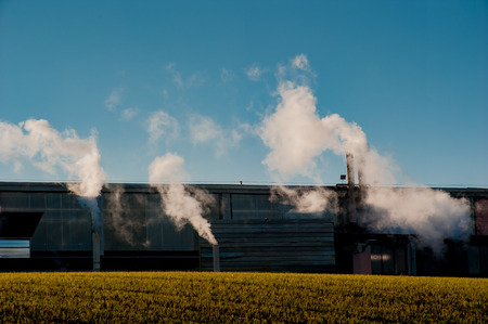 industrial chimneys that pollute the air