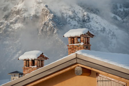 chimney pot on a snow-covered roof