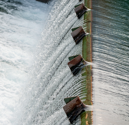 overflow of water in a hydroelectric plant Фото со стока - 99659664