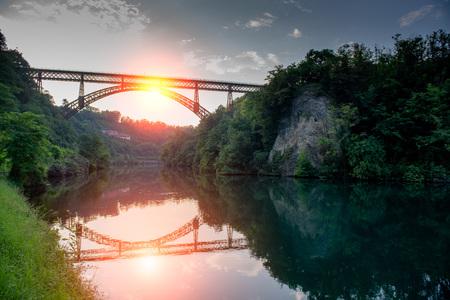 iron bridge on the river adda