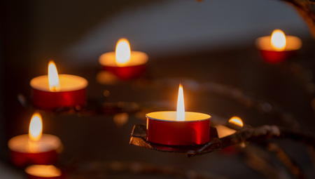 votive candles in iron candlestick Stock Photo