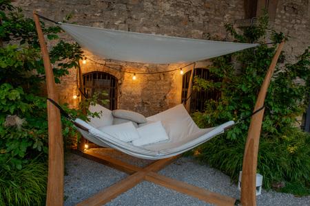 ancient dwelling garden with hammock Reklamní fotografie