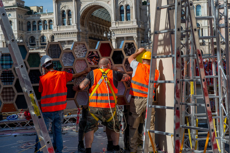Milan Italy September 26th 2018: workers who dismantle the artistic installation in Piazza Duomo in Milan