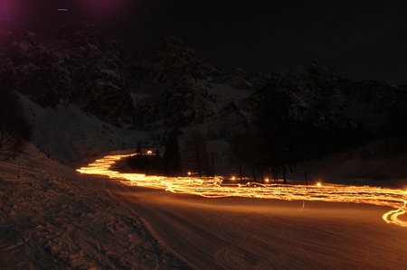 ski descent lit with torches