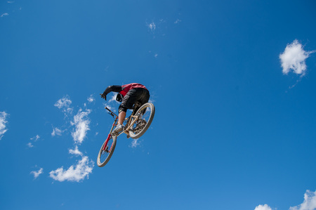 Livigno italy July 27th 2015:boy who finishes the descent by bike with a jump Editorial