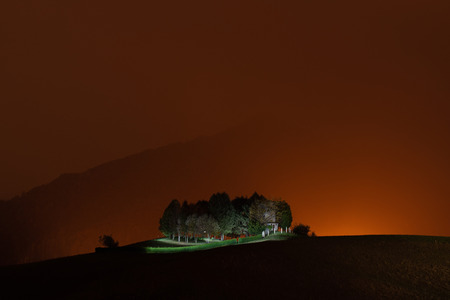 Illuminated hunting post at night