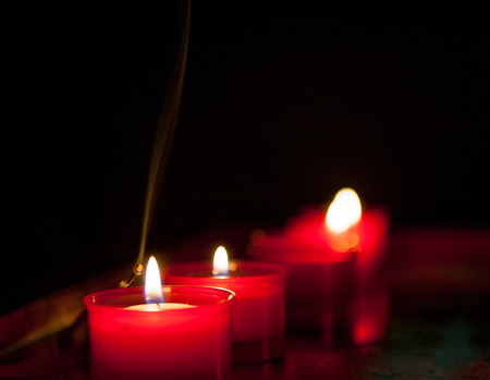 votive candles lit in the church