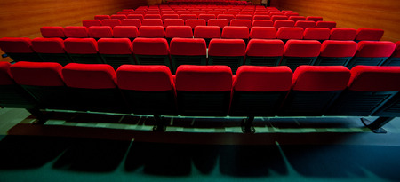 red velvet armchairs in the movie theater Фото со стока