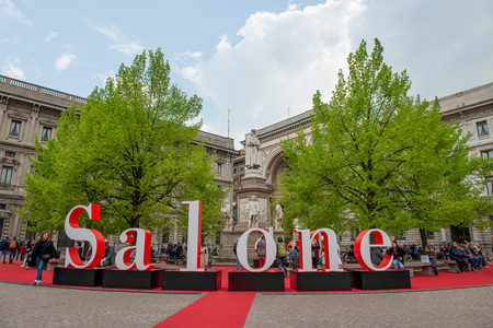 Milan Italy 10 April 2019: Installation to advertise the outside salon with a statue of Leonardo da Vinci in the background