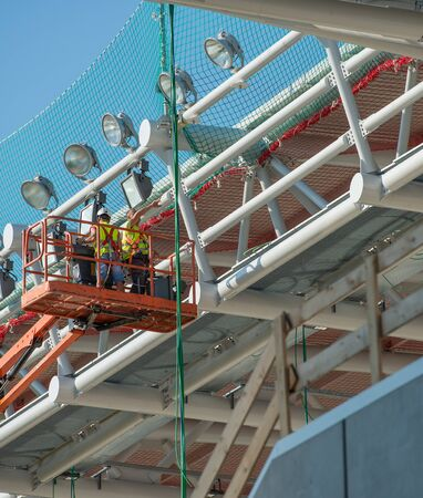 Bergamo Italy 12 September 2019: Workers working on elevating platform while restoring the lighting lamps of the Bergamo stadium