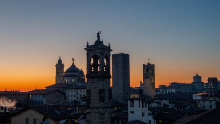 Sunset with towers in the old town of Bergamo Фото со стока