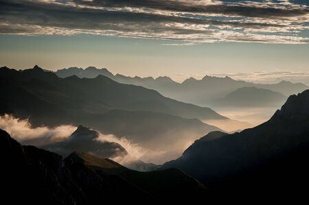 Sunrise with clouds seen from the Arera peak