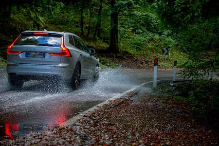 car traveling on flooded road Reklamní fotografie