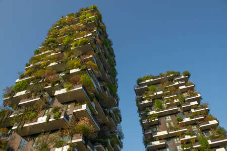 """milan italy march 29 2021: Bosco Verticale """"new and modern skyscraper with trees growing on the balconies, in the Isola district of Milan which is reflected in the water of the fountain Editorial"""