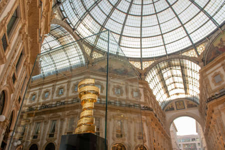 milan italy 3 may 2021: cup awarded to the winner of the 2021 cycling tour of italy on display in the vittorio emanuele gallery in milan