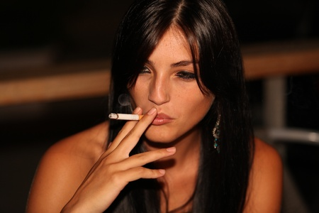 wonderful girl are smoking on night Stock Photo - 11787196