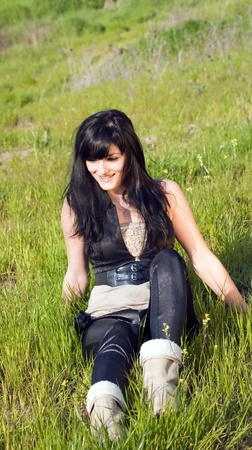 model sitting on the grass Stock Photo - 18056488