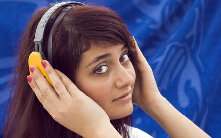 beautiful girl listens to music on headphones