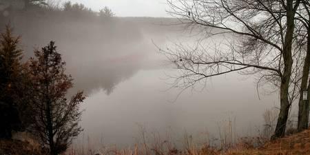 lake and fog in the evening Reklamní fotografie