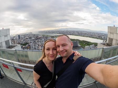 Caucasian couple in front of Osaka Skyline Lizenzfreie Bilder