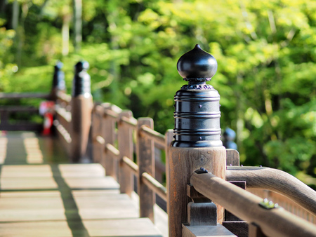 pillars in temple in sun in kyoto Stock Photo