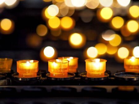 fulfill: candles in cathedral in Strasbourg
