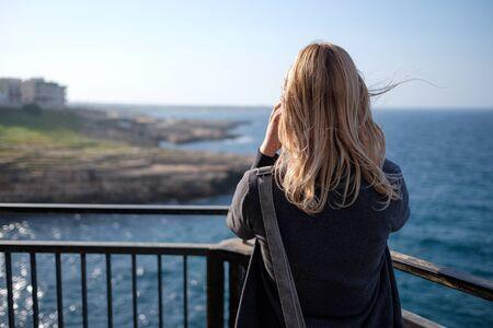 blonde girl at Polignano Coastline
