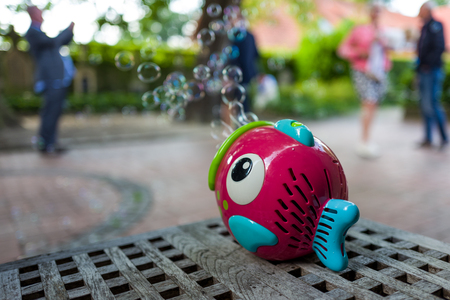 a toy fish and soap bubbles